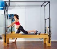 Pregnant woman pilates reformer cadillac exercise Stock Photos