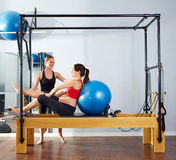 Pregnant woman pilates reformer fitball exercise Royalty Free Stock Photo