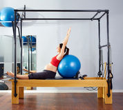 Pregnant woman pilates reformer fitball exercise Royalty Free Stock Image