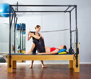 Pregnant woman pilates reformer leg spring Royalty Free Stock Images