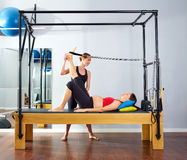 Pregnant woman pilates reformer leg spring Stock Photos