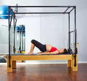 Pregnant woman pilates reformer shoulder bridge Royalty Free Stock Photos