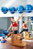 Pregnant woman pilates side stretch exercise Royalty Free Stock Photos