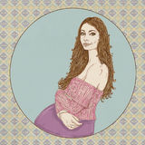 Pregnant woman with pink sweater and long brown hair,. Prenatal Stock Image