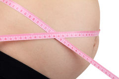 Pregnant woman with pink tape measure Stock Photo