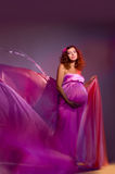 Pregnant woman in pink tissue Stock Photography