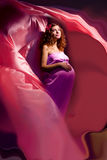Pregnant woman in pink and violet dress 3 Royalty Free Stock Photo