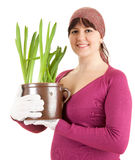 Pregnant woman with plant in pot Royalty Free Stock Image
