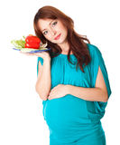 A pregnant woman with a plate of vegetables Royalty Free Stock Photography