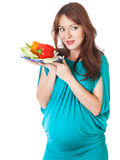 A pregnant woman with a plate of vegetables Stock Image