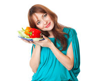A pregnant woman with a plate of vegetables Royalty Free Stock Image