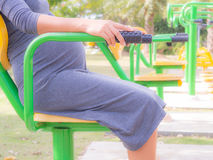 Pregnant woman Play Fitness In the park. In the morning stock images