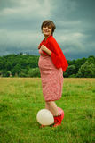 Pregnant Woman playing with ballons Stock Photography