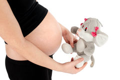 Pregnant Woman with Plush Toy Stock Photography