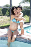 Pregnant Woman Poolside with Toddler Daughter (3) Stock Photography
