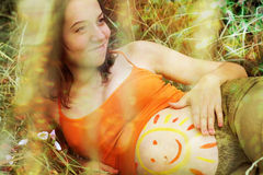 Pregnant woman portrait with drawing of smile. Royalty Free Stock Photo