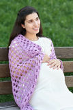 Pregnant woman portrait, sit on bench in summer city park, bright sunny day and green grass, beautiful people portrait Stock Photos