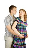 Pregnant woman poses with  husband Stock Image
