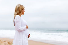 Pregnant woman posing stock photo