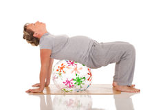 Pregnant woman practices yoga Royalty Free Stock Photos