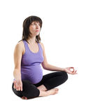 Pregnant woman practices yoga Stock Images