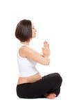 Pregnant woman practicing yoga Stock Image