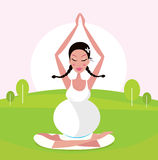 Pregnant woman practicing yoga asana in park Stock Image