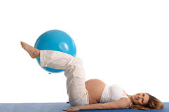 Pregnant woman practicing yoga with blue ball Royalty Free Stock Photo