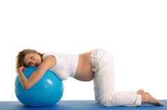 Pregnant woman practicing yoga with blue ball Royalty Free Stock Photos