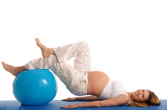 Pregnant woman practicing yoga with blue ball Royalty Free Stock Image