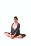 Pregnant woman practicing yoga, gray casual clothing. Pregnant woman practicing yoga, free gray casual clothing, sitting posture, Baddha Konasana (Bound Angle Royalty Free Stock Image