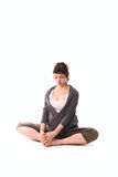 Pregnant woman practicing yoga, gray casual clothing Royalty Free Stock Images