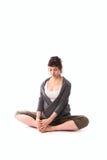 Pregnant woman practicing yoga, gray casual clothing. Pregnant woman practicing yoga, free gray casual clothing, sitting posture, Baddha Konasana (Bound Angle Royalty Free Stock Images