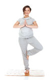 Pregnant woman practising aerobics Stock Photos