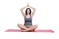 Pregnant woman practising yoga and meditating Royalty Free Stock Photography