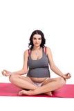 Pregnant woman practising yoga and meditating Royalty Free Stock Image
