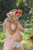 Pregnant Woman Praying Stock Photo