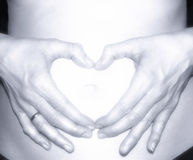 Pregnant woman pregnancy concept heart on stomach Royalty Free Stock Photo