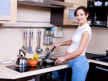 Pregnant Woman Prepares To Eat Royalty Free Stock Image