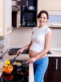 Pregnant woman prepares to eat Stock Photos