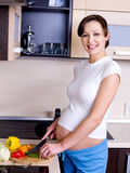 Pregnant woman prepares to eat Stock Photography