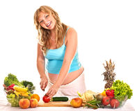 Pregnant woman preparing food . Pregnant woman preparing food in the kitchen Isolated royalty free stock photography