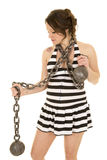Pregnant woman in a prision skirt with chain look down side Royalty Free Stock Photography