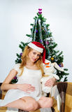 Pregnant woman with a rabbit (symbol 2011) Stock Images