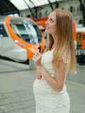 Pregnant woman at railway station Royalty Free Stock Photography