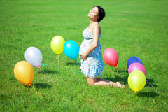 Pregnant woman rainbow umbrella Royalty Free Stock Image