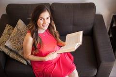 Pregnant woman reading a book Stock Photos