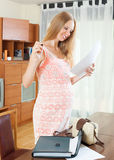 Pregnant woman reading paper document Royalty Free Stock Photo