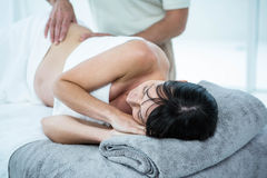 Pregnant woman receiving a back massage from masseur Royalty Free Stock Images