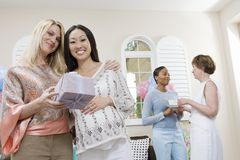 Pregnant Woman Receiving Gift From Friend stock images
